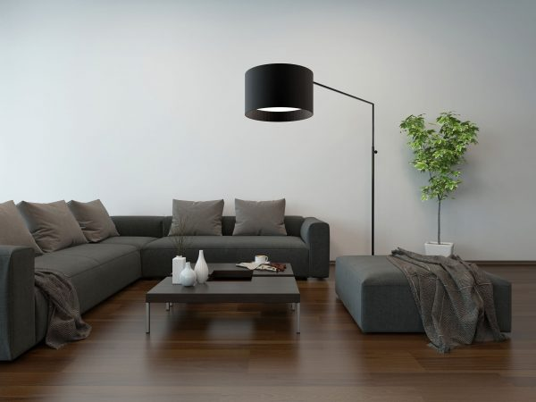 Living room interior with gray couch, coffe table and floor lamp